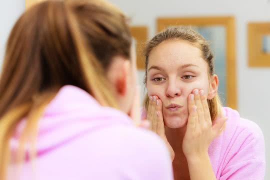 Woman using non-microbead scrub