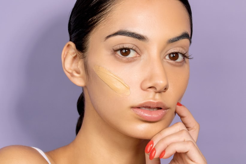 Model with foundation swatch on cheek